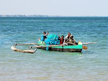 Malagasy fishing canoe on the see with fishermen Stock Photography