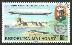 Graf Zeppelin over Rio de Janeiro. Malagasy Republic  Madagascar  - stamp printed 1976, Multicolor memorable Edition offset printing, Topic Aviation, Series 75 Stock Photography