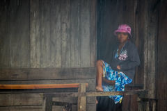Malagasy woman in the rain Stock Photo