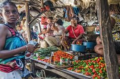 Malagasy woman are selling some vegetables on the bazaar Stock Photography