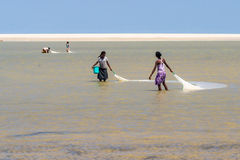 Malagasy women fishing Stock Photos