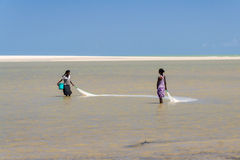 Malagasy women fishing Royalty Free Stock Images