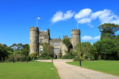Malahide Castle With Flags. Malahide Castle, county Dublin on a sunny day with flags flying Stock Photography