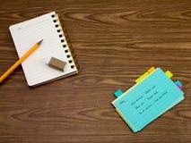 Malaie; Lernen von neuen Sprachschreibens-Wörtern auf dem Notizbuch Lizenzfreie Stockfotos