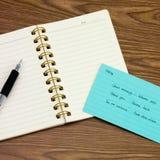 Malaie; Lernen von neuen Sprachschreibens-Wörtern auf dem Notizbuch Stockfotos