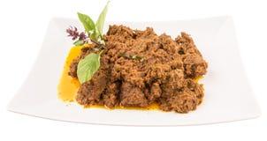 Malajiska dropp för nötköttRendang maträtt Arkivbild