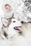 Malamute puppy with a little girl Stock Photos