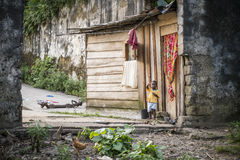 MALANZA/SAO TOME - 2 JAN 2016 - Small child at the door house. In são tom royalty free stock photography