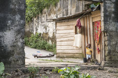 MALANZA/SAO TOME - 2 JAN 2016 - Small child at the door house. In são tom stock photography