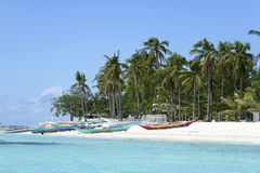 Malapascua island banka fishing boats white sand beach philippines Stock Photo