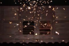 Malar som flyger runt om ljusa kulor Royaltyfria Bilder