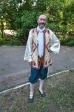 Malarz w ludowych kostiumach Fotografia Stock