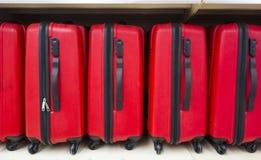 Malas de viagem vermelhas Fotografia de Stock Royalty Free