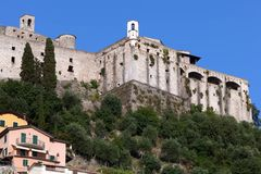 Malaspina Castle of Massa. The mighty Malaspina Castle of Massa, Italy crowns the top of a rocky hill and from its position dominates the wide underlying plain stock images