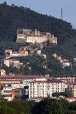 Malaspina Castle of Massa. The mighty Malaspina Castle of Massa, Italy crowns the top of a rocky hill and from its position dominates the wide underlying plain Royalty Free Stock Images