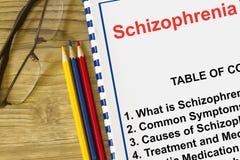 Malattia di disturbo mentale di schizofrenia con l'oggetto relativo su una copertura di una conferenza fotografia stock