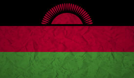 Malawi flag with the effect of crumpled paper and grunge stock illustration