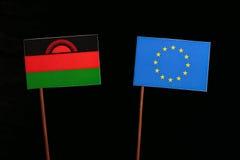 Malawi flag with European Union EU flag isolated on black. Background Royalty Free Stock Images