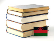 Malawi flag with pile of books  on white background Royalty Free Stock Photo