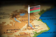 Malawi marked with a flag on the map.  royalty free stock photos