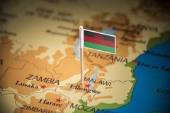 Malawi marked with a flag on the map.  royalty free stock photo