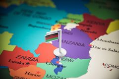 Malawi marked with a flag on the map.  stock photos