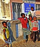Malawi/Mozambique Border Post. Impoverished kids linger outside the Immigration & Customs office on he Mozambique side of the border with Malawi. High levels of royalty free stock image
