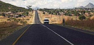 Malawi road. Road  of malawi with people and cars Royalty Free Stock Images
