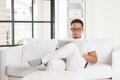 Malay Asian male using internet Royalty Free Stock Image