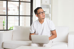 Malay Asian male using internet Stock Images