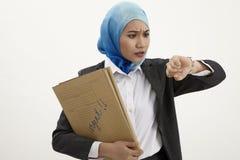 Malay business woman checking time Stock Image