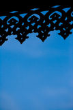 Malay carving silhouette. On blue background Stock Photo