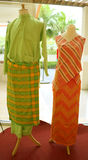 Malay costume. A male and female Malay costume worn in Malaysia, Indonesia, Singapore and Brunei royalty free stock photography