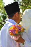 Malay Couple hold Wedding Flower Bouquet Royalty Free Stock Image