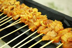 Malay Delicacy - Satay Cuisine. Traditional Malay and Indonesian delicacy of sliced chicken meat on bamboo skewers grilled with charcoal fire stock photography