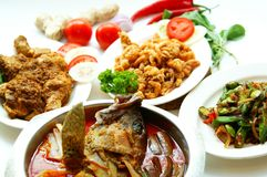 Malay Dishes. Variety of Malay dish consist of fush head curry, chicken rendang, crispy cuttlefish and etc royalty free stock image