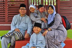 A malay family posing for the camera. With a lot of different facial expression stock photos