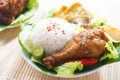 Malay food nasi ayam penyet. Popular Indonesian local food nasi ayam penyet, indonesian fried chicken rice with sambal belacan. Fresh hot with steam smoke royalty free stock photo