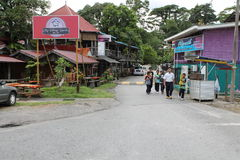 Malay Kampung house and road Stock Photo