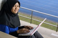 Malay lady studying with laptop Stock Photo