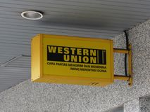 Malay Language Western Union Electric Signboard. A Malay language Western Union electric signboard in Malaysia. Picture was taken at one of the many branches of Royalty Free Stock Photos