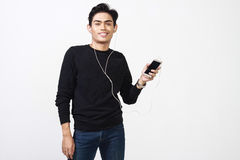 Malay man using his headset to hear music royalty free stock image