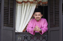 Malay muslim man open a traditional window Stock Photo