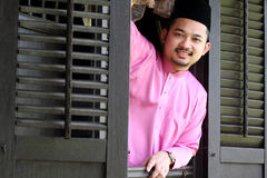 Malay muslim man open a traditional window Royalty Free Stock Photography