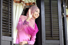 Malay muslim woman wavings hand royalty free stock photo