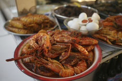 Malay prawn and seafood dish. A dish of curry prawn and a selection of Malay cuisine seafood dishes at day market in Kota Bharu, Kelantan, Malaysia Royalty Free Stock Photos