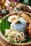 Malay rice dish nasi kerabu. Nasi kerabu is a type of nasi ulam, popular delicious Malay rice dish. Blue color of rice resulting from the petals of butterfly-pea stock images