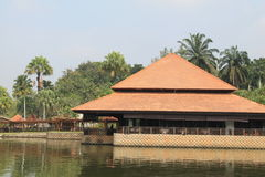 Malay style building on lake Stock Images