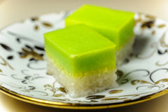 Malay Traditional Dessert - Seri Muka on a fancy plate. Seri Muka (also Kuih Seri Muka or Sri Muka (Malay: Pretty face) or Kuih Salat ) is a two-layered dessert Royalty Free Stock Photo