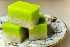 Malay Traditional Dessert - Seri Muka on a fancy plate. Seri Muka (also Kuih Seri Muka or Sri Muka (Malay: Pretty face) or Kuih Salat ) is a two-layered dessert Stock Photography